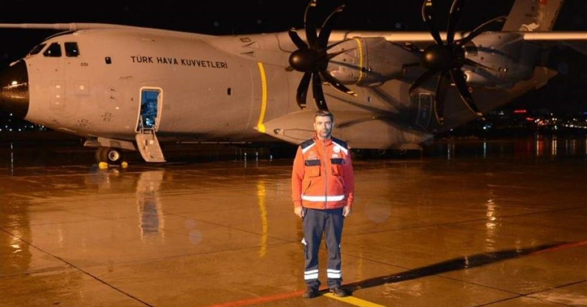 Evren Karaal poses in front of Koca Yusuf, the military cargo plane he traveled on for an evacuation operation from China, in this undated photo. (AA Photo)