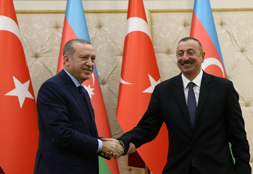 President Erdou011fan and Azerbaijani President Aliyev shake hands at a joint press conference after the 6th Turkey-Azerbaijan High-Level Strategic Cooperation Council Meeting yesterday in Baku.