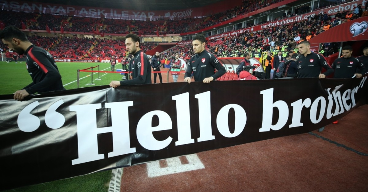 Before the match, the Turkish team carried a banner reading u201cHello, Brother,u201d the last words of Daoud Nabi who greeted the Christchurch attacker before the latter killed 50 Muslims in New Zealand.