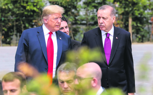President Recep Tayyip Erdoğan speaks with U.S. President Donald Trump ahead of the opening ceremony of the NATO summit, July 11.