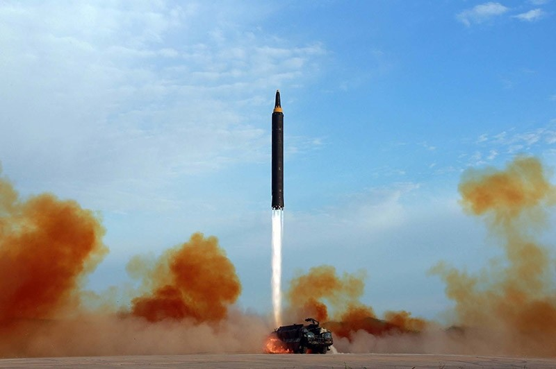 This undated file photo distributed by the North Korean government shows what was said to be the test launch of an intermediate range Hwasong-12 in North Korea. (AP Photo)