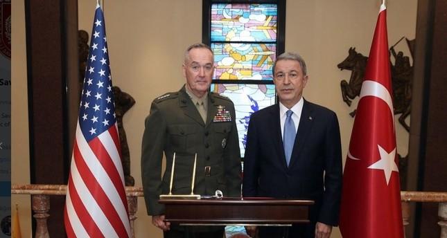 Turkish National Defense Minister Hulusi Akar R and U.S. Joint Chiefs Chairman Gen. Joseph Dunford