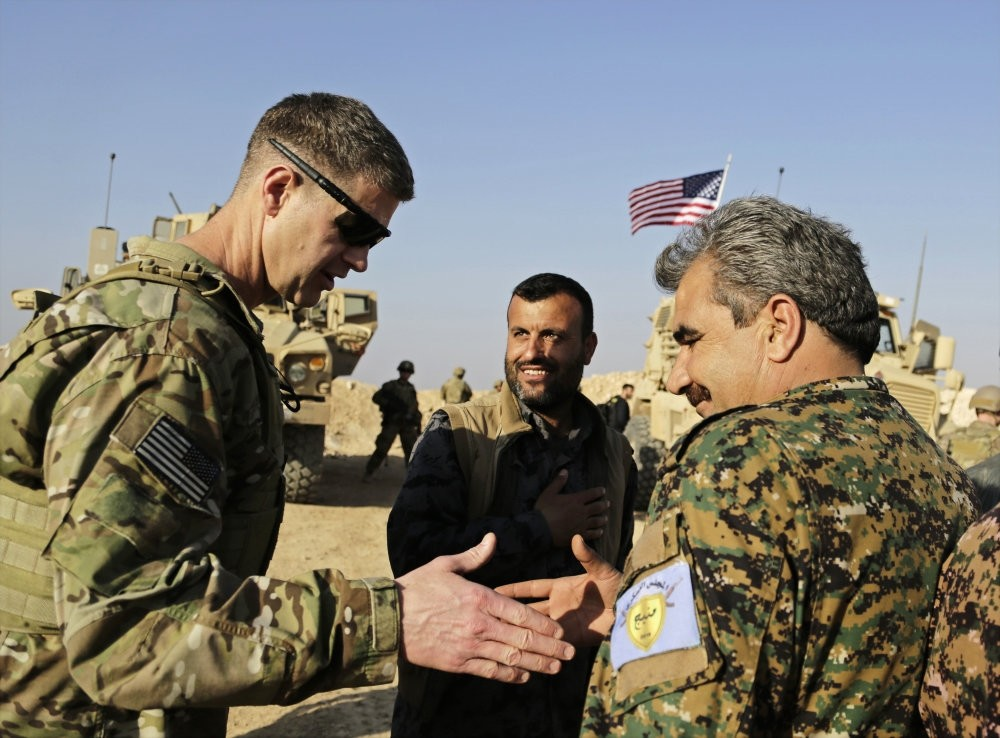 A U.S. Army general (L) thanks a YPG militant during a visit to a small outpost near the town of Manbij, northern Syria, Feb. 7.