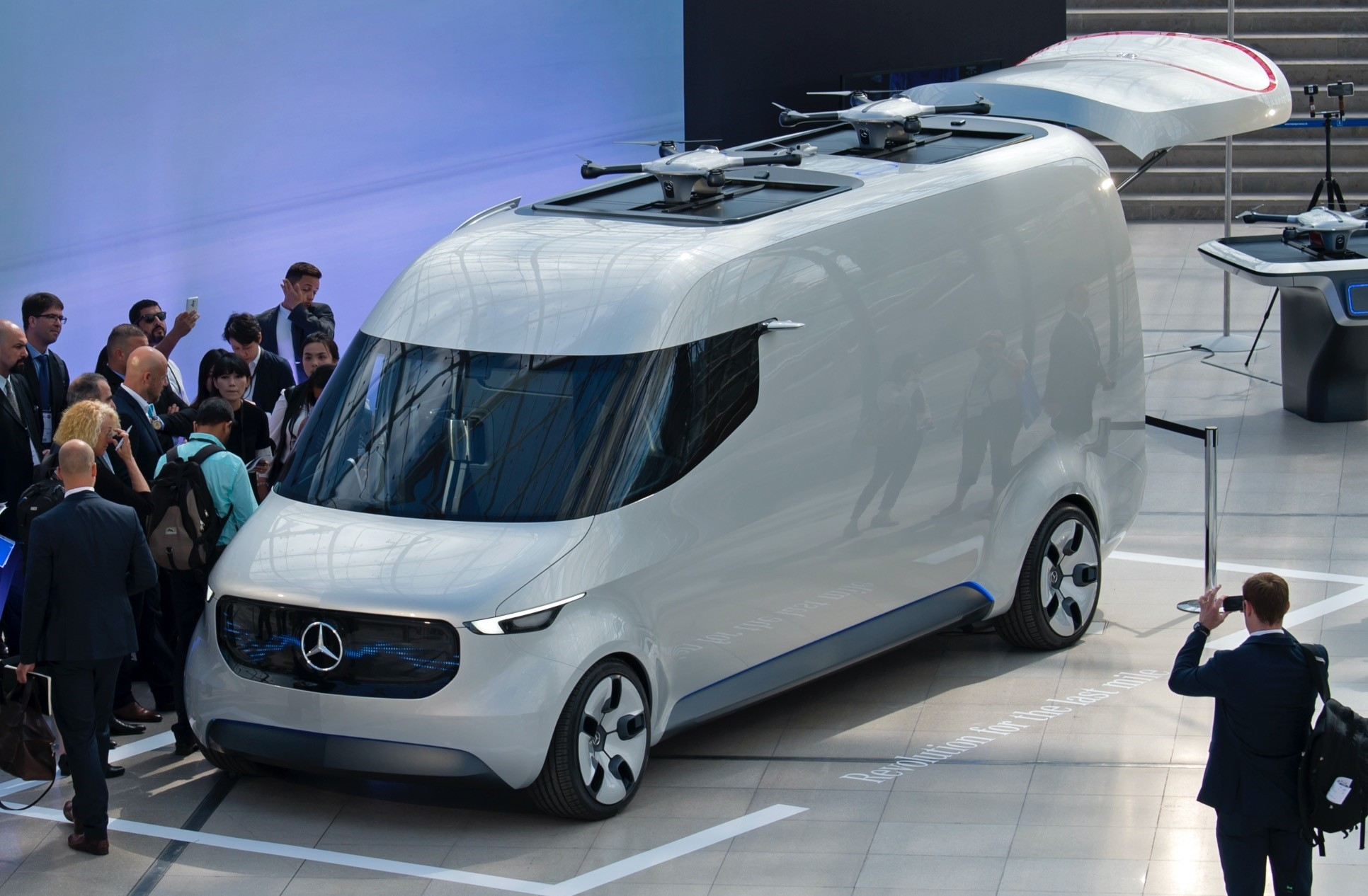 Visitors stand around the Matternet Drone-equipped delivery van , Mercedes Vision Van, at the International Transport Forum 2017 in Leipzig.