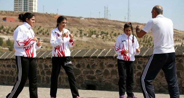 Kickboxer sisters power each other up for more gold medals