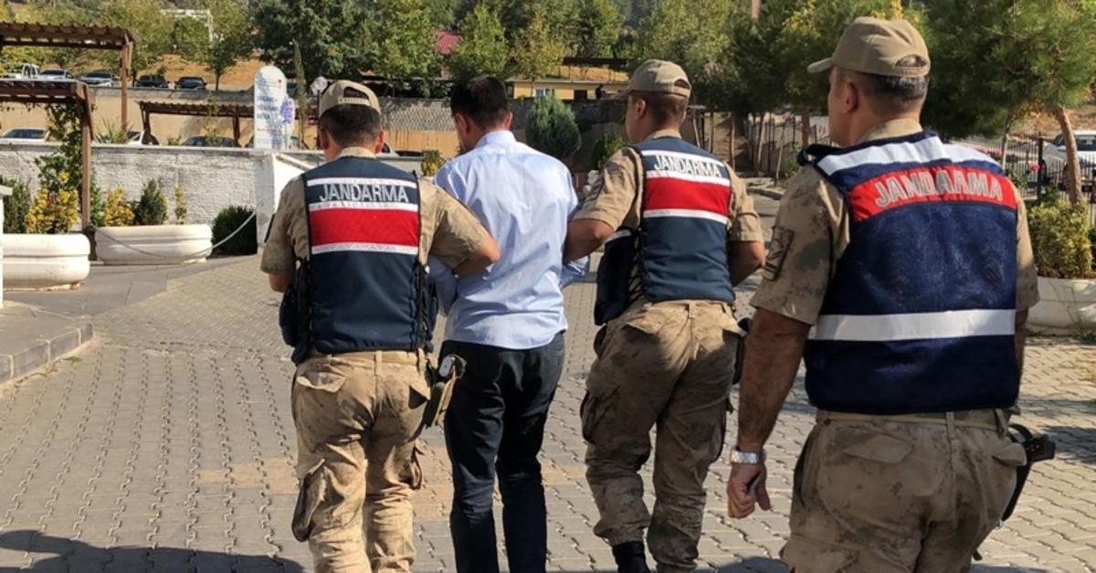 Gendarme troops escort a FETu00d6 suspect captured in southern province of Kahramanmarau015f, Oct. 15, 2019. (AA Photo)