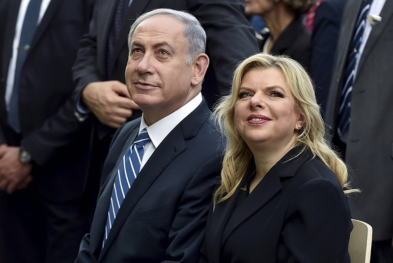 In this Aug. 27, 2015 file photo, Israel's Prime Minister Benjamin Netanyahu (L) sits next to his wife Sara during a visit at the Expo 2015 global fair in Milan, northern Italy. (Reuters Photo)