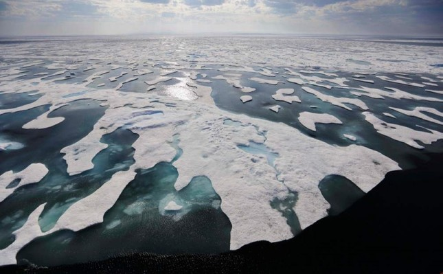 Sea ice melts on the Frankin Strait along the northwest passage in the Canadian Arctic Archipelago, Saturday, July 22, 2017. (AP Photo)