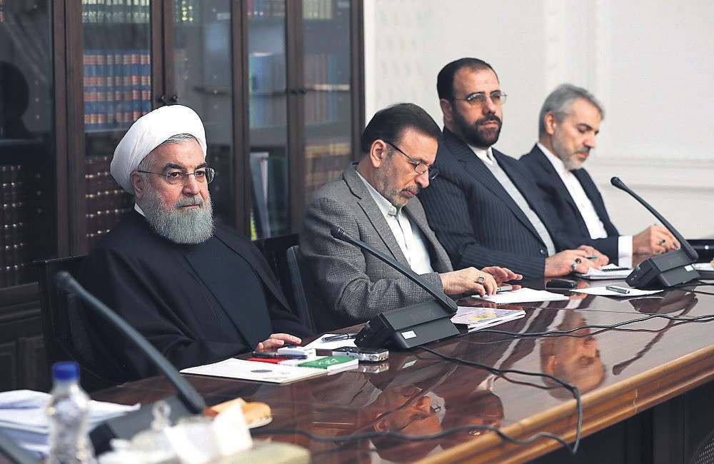 Iranian President Hassan Rouhani (L) at a meeting with heads of parliament commissions, Tehran, Iran, Jan. 1.
