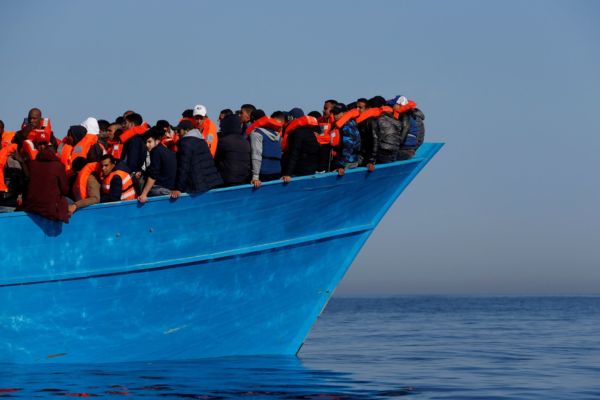 Migrants on a wooden boat await rescue by the Malta-based NGO Migrant Offshore Aid Station (MOAS) in the central Mediterranean in international waters off the coast of Sabratha in Libya, April 15, 2017 (Reuters File Photo)