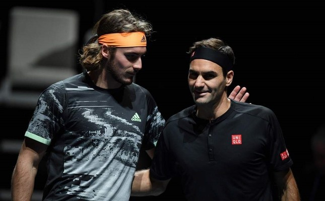 Tsitsipas L and Federer interact before the men's singles semi-final match on day seven of the ATP World Tour Finals in London on November 16, 2019. AFP Photo