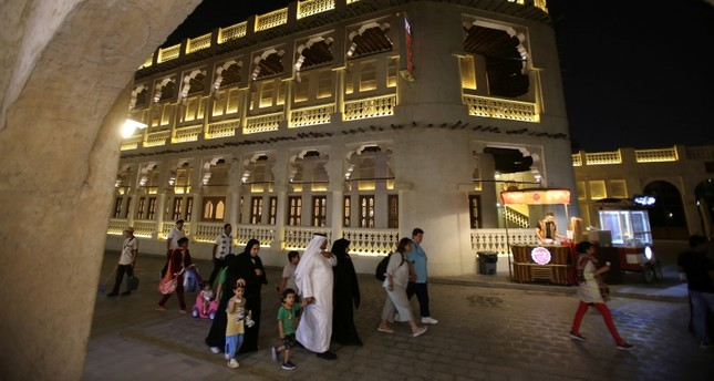 In this Thursday, May 3, 2018 photo, a Qatari family visit the Waqif Souq, or market, in Doha, Qatar.  (AP Photo)