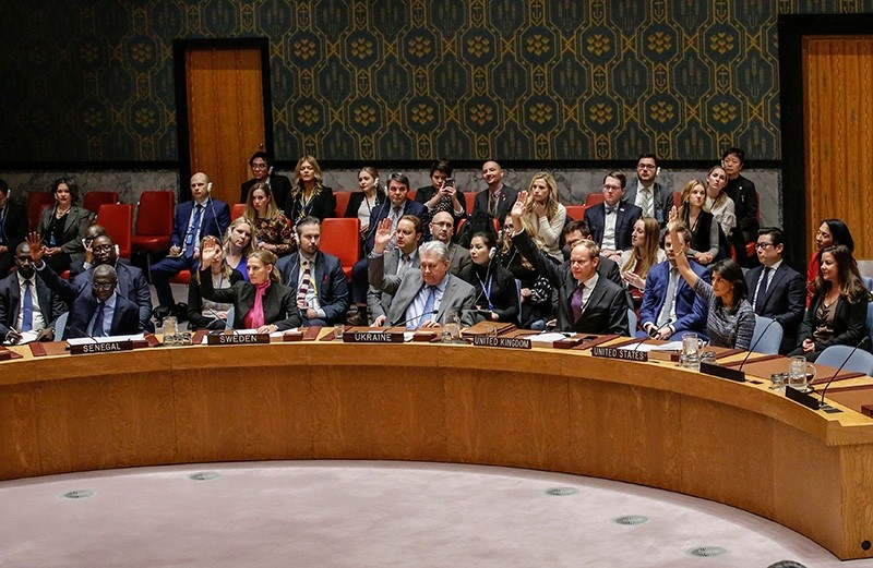 Members of the UN Security Council vote 15-0 to impose new sanctions on North Korea during a Security Council meeting over North Korea on Dec. 22, 2017, at U.N. Headquarters in New York City. (AFP Photo)