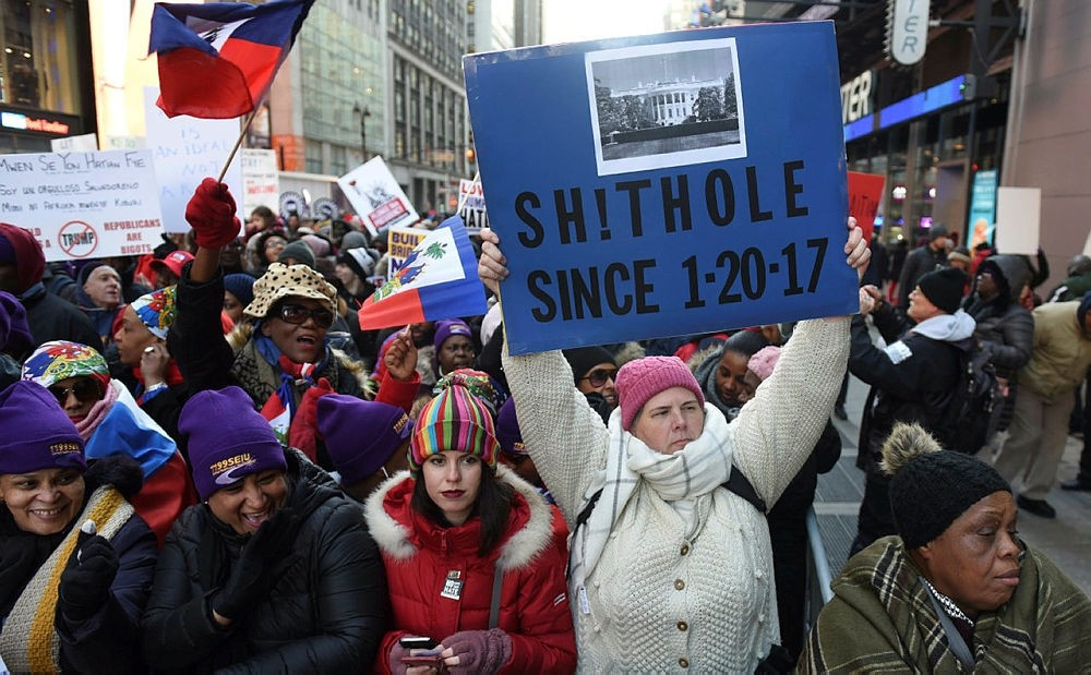 Protesters carry signs during a march on Martin Luther King Jr. Day in Times Square, called Rally Against Racism: Stand Up for Haiti and Africa in New York January 15, 2018. (AFP Photo)