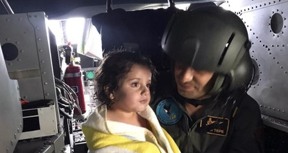 pFour-year-old Liya's parents thanked the Turkish Coast Guard for evacuating them to safety after 24 Iraqi migrants perished in a sinking boat last week. Liya's photo in the arms of a Coast Guard...
