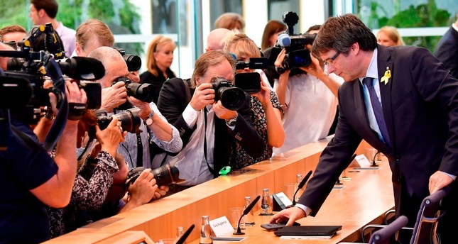 Catalonia's deposed president Carles Puigdemont arrives to give a press conference on July 25, 2018 in Berlin. AFP Photo