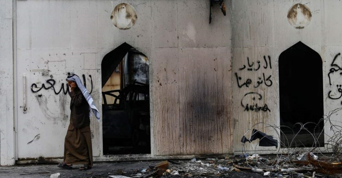 An Iraqi man walks past the Iranian consulate after Iraqi demonstrators stormed and set fire to the building, Najaf, Dec. 3, 2019. (REUTERS Photo)