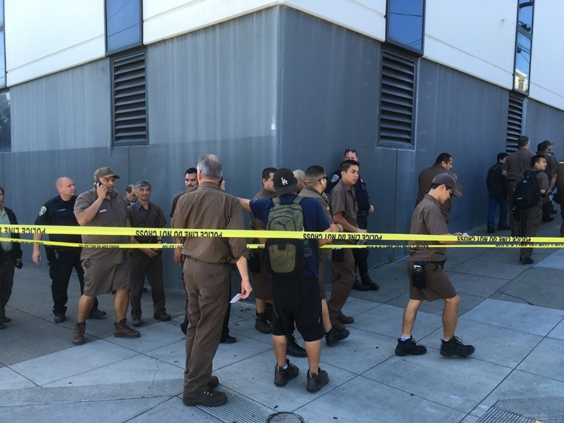 UPS workers gather outside after a reported shooting at a UPS warehouse and customer service center in San Francisco on Wednesday, June 14, 2017 (AP Photo)