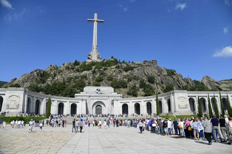 In this file photo taken on July 15, 2018 people wait to enter the basilica at the Valley of the Fallen in San Lorenzo del Escorial near Madrid. (AFP Photo)