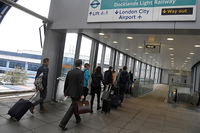Passengers alight from a train to enter City Airport in London, Britain (Reuters Photo)