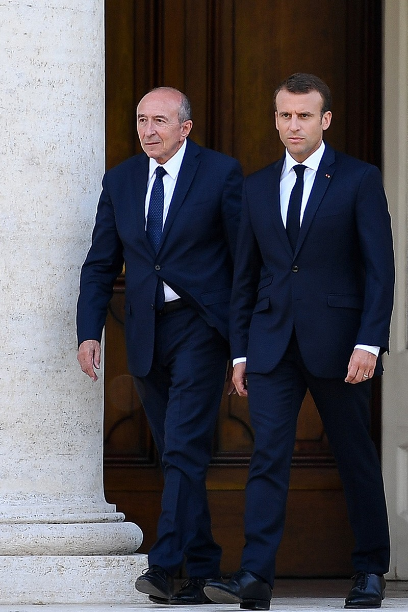 In this file photo taken on June 26, 2018, French President Emmanuel Macron (R) and French Interior Minister Gerard Collomb arrive for a press conference following the president's first official visit to the Vatican. (AFP Photo)