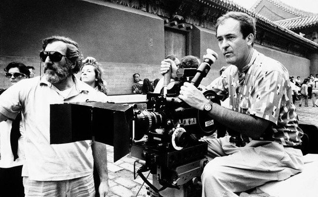 In this May 2, 1987 file photo Italian movie director Bernardo Bertolucci, right, checks a scene during the filming go the movie The Last Emperor, in the Forbidden City of Beijing, China. (AP Photo)