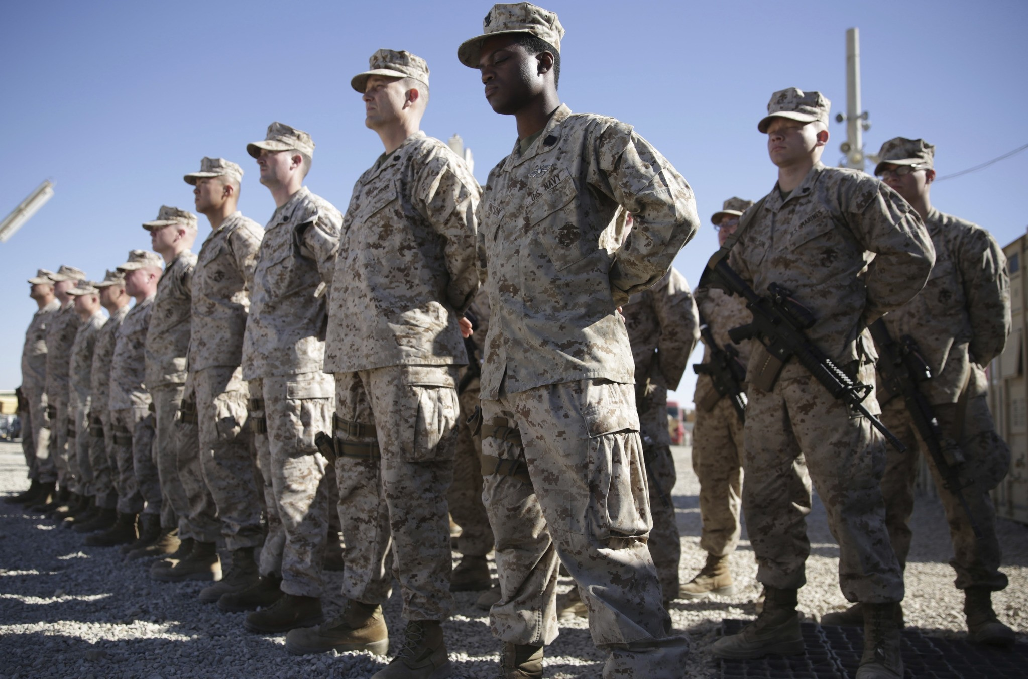 U.S. Marines watch during the change of command ceremony at Task Force Southwest military field in Shorab military camp of Helmand province, Afghanistan.(AP Photo)
