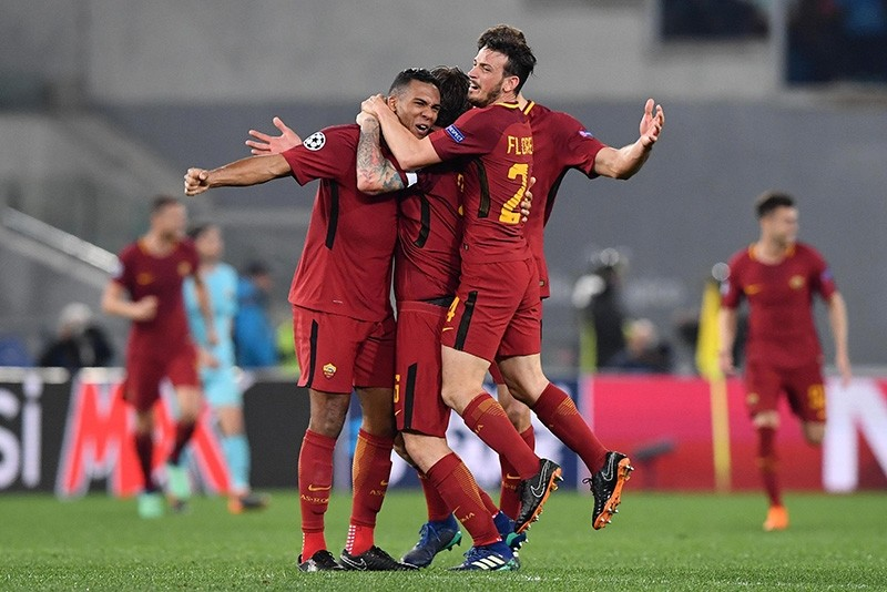 Roma's players celebrate their win at the end of the UEFA Champions League quarter final second leg match between AS Roma and FC Barcelona at Olimpico stadium in Rome, Italy, 10 April 2018. (EPA Photo)