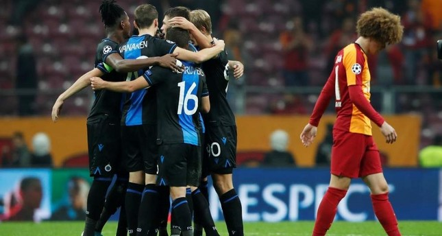 Club Brugge players celebrate after the match while Galatasaray's Erencan Yardımcı walks away, Istanbul, Nov. 26, 2019. Reuters Photo