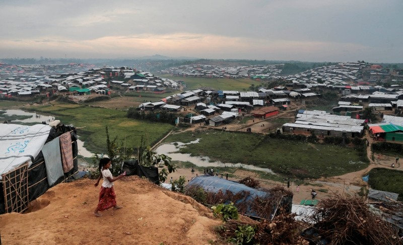 In this Nov. 17, 2017, file photo, a Rohingya Muslim child who crossed over from Myanmar into Bangladesh, plays in front of her makeshift tent at Jamtoli refugee camp in Ukhiya, Bangladesh. (AP Photo)