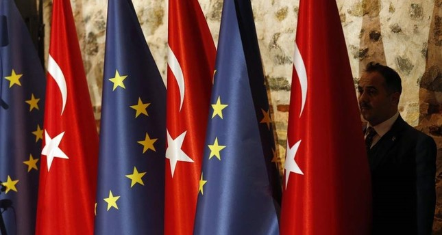The Turkish and EU flag at the opening session of a high-level meeting to improve economic and business ties between the EU and Turkey in Istanbul, Feb. 28, 2019. AP Photo