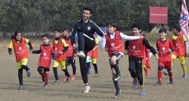In this picture taken Jan. 6, 2019, Pakistani youths exercise with local coaches at Atletico de Madrid club's new facility for developing football in Lahore, Pakistan. (AFP Photo)