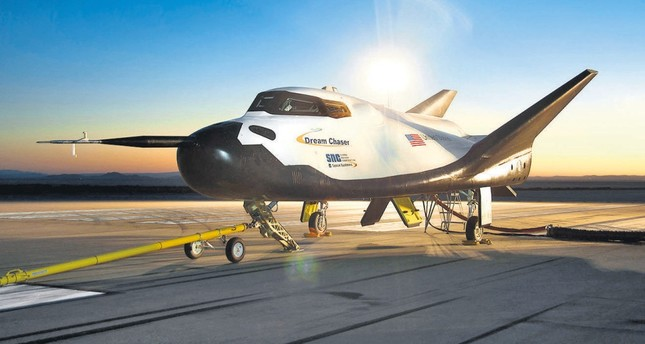 Dream Chaser, above, will carry cargo to NASA's space station starting in 2020.