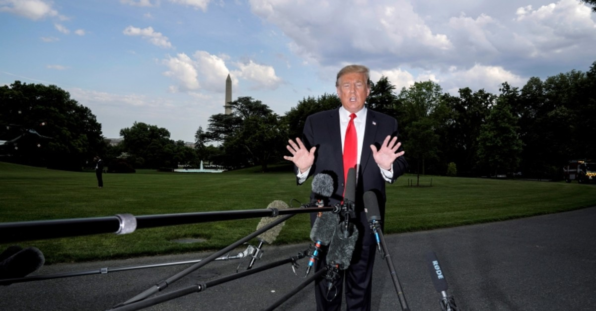 U.S. President Donald Trump speaks to the media as he departs for a campaign rally from the White House in Washington, U.S., May 20, 2019. (Reuters Photo)