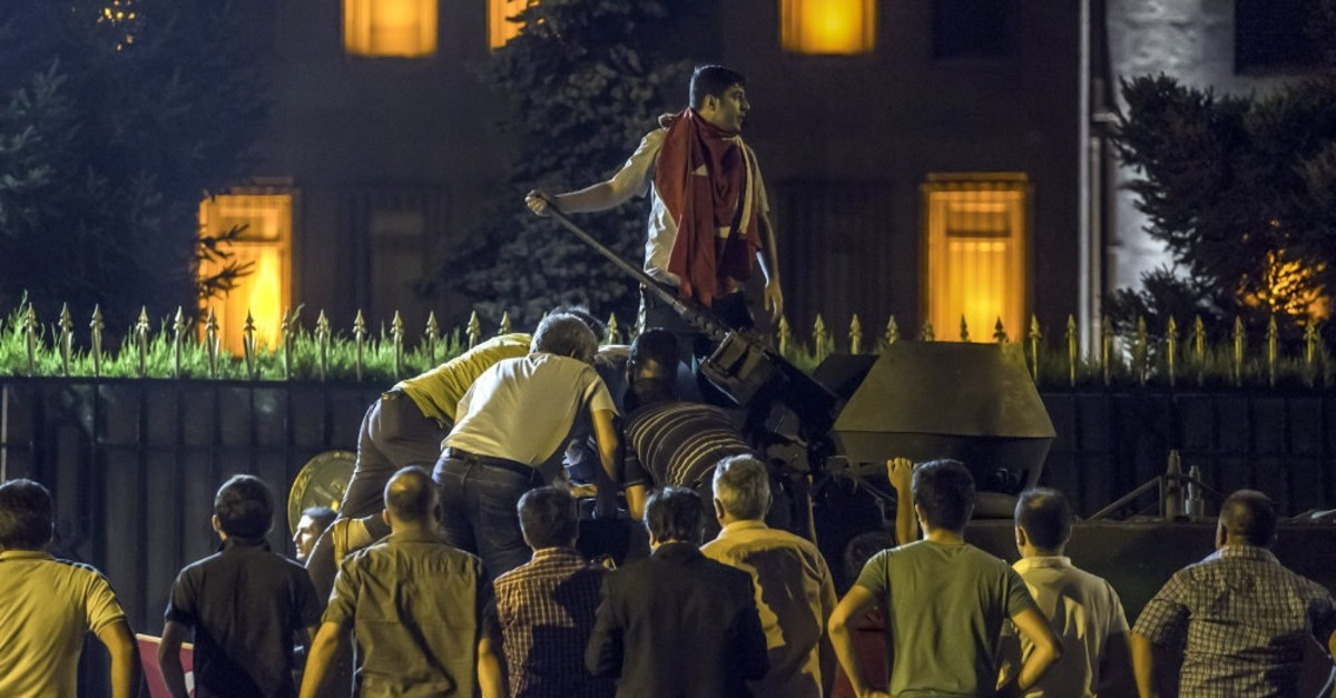 An anti-coup crowd climb on top of a tank controlled by putschists outside the Office of Chief of General Staff, July 15, 2016. The army headquarters was taken over by putschists during the coup attempt.