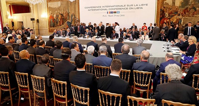 جانب من مؤتمر باريس المنعقد بمشاركة 20 دولة وأطراف النزاع الرئيسية