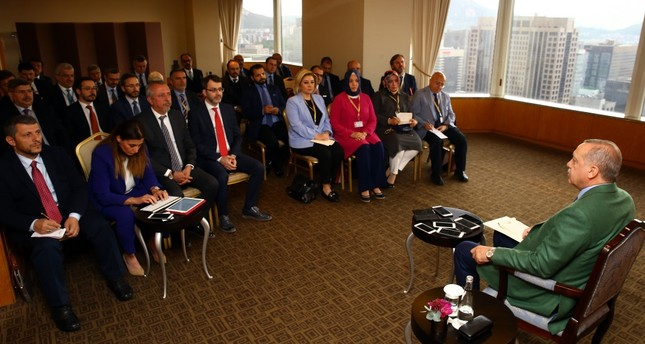 President Erdoğan talks to the members of the Turkish press during his two-day state visit to South Korea yesterday.