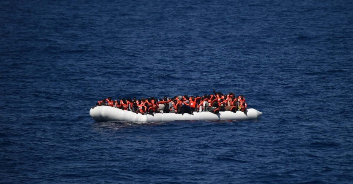 This file photo taken on May 24, 2016 shows refugees waiting on a rubber boat to be rescued during an operation at sea  (AFP Photo)