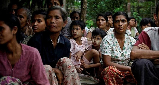 Rohingya Muslums sit in a temporary refugee camp after losing their homes during the violence in the Rakhine state.