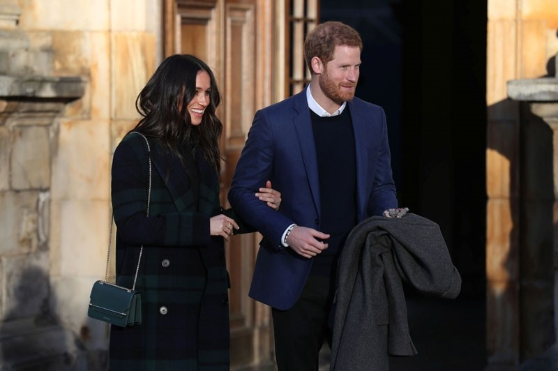 Britain's Prince Harry and his fiancee Meghan Markle attend a reception for young people at the Palace of Holyroodhouse in Edinburgh, Britain February 13, 2018. (Reuters Photo)