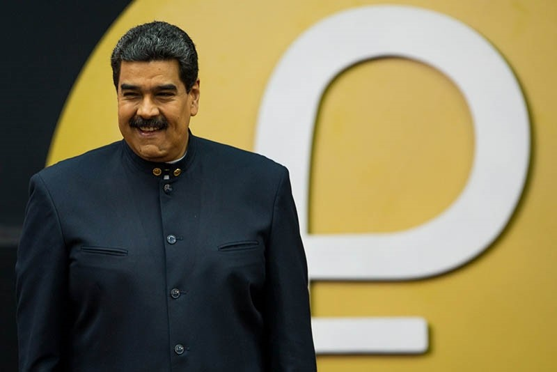 Venezuelan President Nicolas Maduro during a press conference with the new Venezuelan cryptocurrency 'petro' logo in the background in Caracas, Venezuela, March 22, 2018. (EPA Photo)