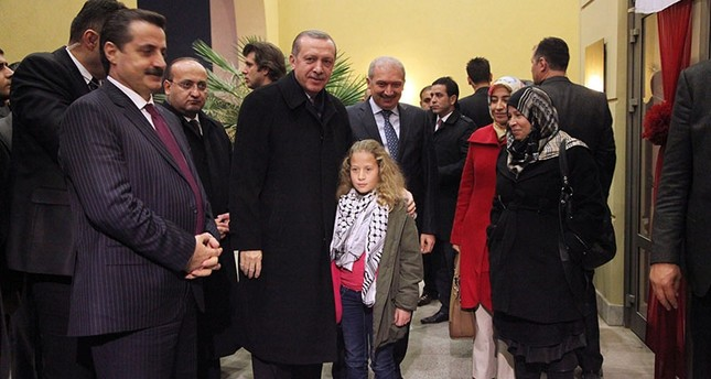This file photo dated Dec. 31, 2012 shows then Prime Minister Recep Tayyip Erdoğan and Palestinian girl Ahed al-Tamimi in Şanlıurfa, southeastern Turkey. (IHA Photo)