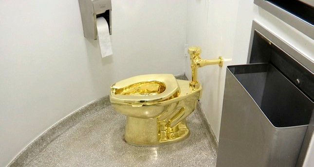 This Sept. 16, 2016 file image made from a video shows the 18-karat toilet, titled America, by Maurizio Cattelan in the restroom of the Solomon R. Guggenheim Museum in New York (AP Photo)