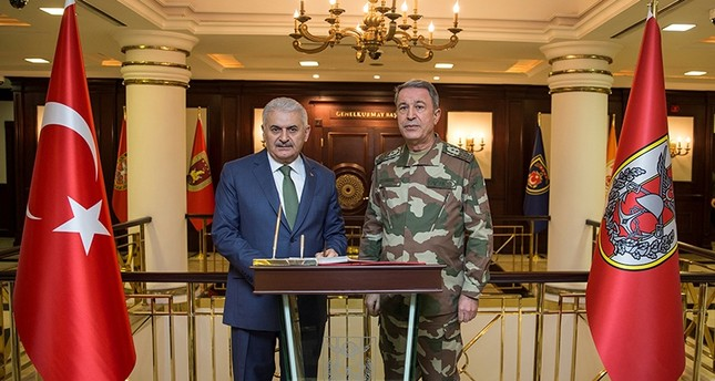 Prime Minister Binali Yıldırım meets with Chief of the General Staff Hulusi Akar at the Armed Forces' headquarters in Ankara, Turkey January 20, 2018. (Photo courtesy of Prime Minister's Press Office)
