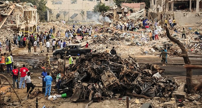 A picture taken on Oct. 15, 2017, shows a general view of the scene of the explosion of a truck bomb in the center of Mogadishu. (AFP Photo)