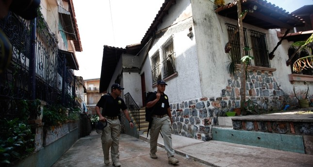 Panamanian authorities observe a house during anti human trafficking operation in Panama City, Panama (EPA Photo)