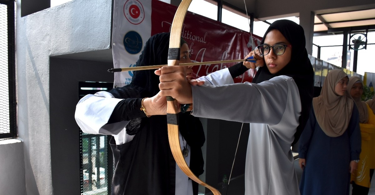 Instructor Adriana Amin Zahari trains a student.