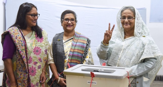 Bangladeshi Prime Minister Sheikh Hasina flashes the peace sign after casting her vote at a polling station, Dhaka, Dec. 30.