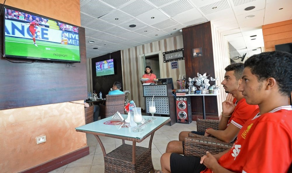 Egyptian Liverpool supporters watch the opening game of the English Premier League between Liverpool and West Ham at a restaurant in Cairo, on Aug. 12.