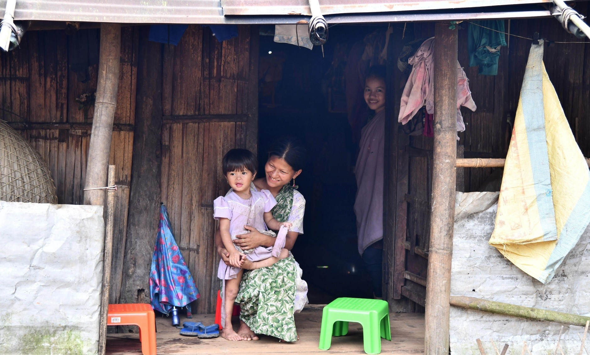 Pyndaplin Shabong, 39, with her daughter at her house in Kongthong village.